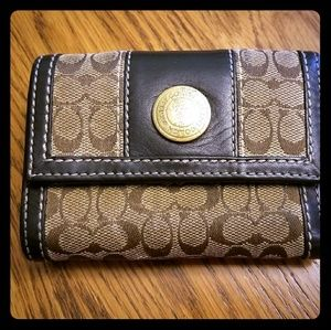 Brown and tan coach wallet.